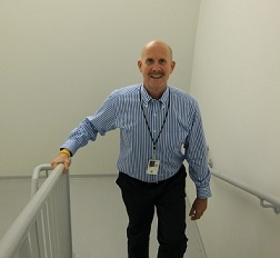 Dr. Howard walking the stairs at work