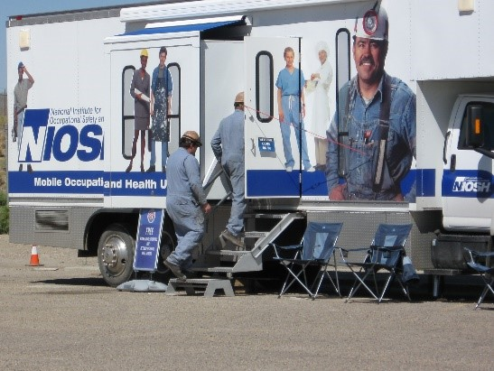 Miners entering a mobile screening vehicle