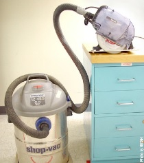 Attaching a regular shop vacuum to a dust-collecting circular saw
