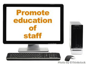 Hands typing on a computer with a banner over the photo that says Promote education of staff