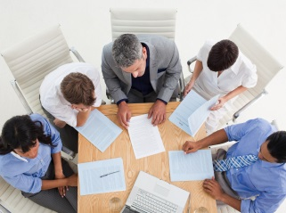 Group of 5 people having a meeting.