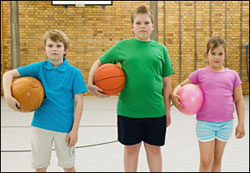 photo of three kids with basketballs