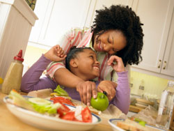 photo of a mother and daughter eating