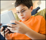 photo of boy playing video games