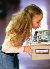 photo of a girl at a water fountain