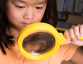 Little girl with magnifying glass