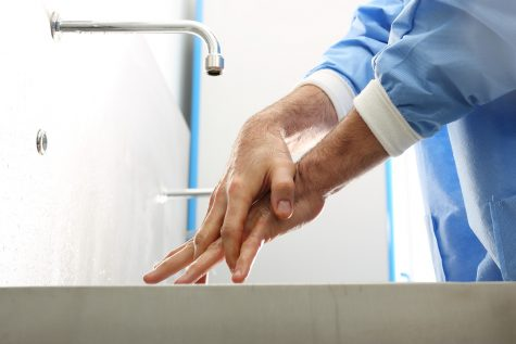 Clinician washing their hands.