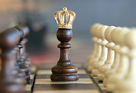 "The image shows ""chess success"" with a crown on the Queen chess piece's head. Free photo."