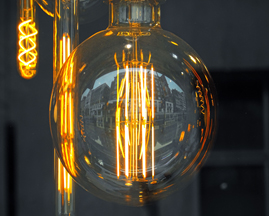 Photo shows lightbulb innovations (a large globe and elongated versions). Free photo.