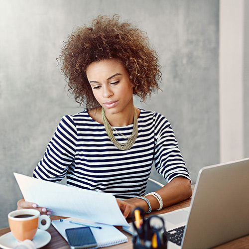 Woman reading Plain Writing Act Compliance Report