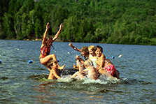 children swimming in lake