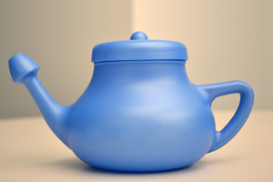 Image of a blue neti pot.