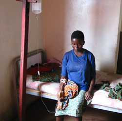 Image of a patient hooked up to an IV receiving treatment for African Trypanosomiasis.