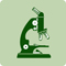 A green icon of a microscope.