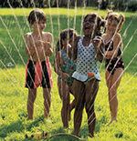 Kids playing in a sprinkler