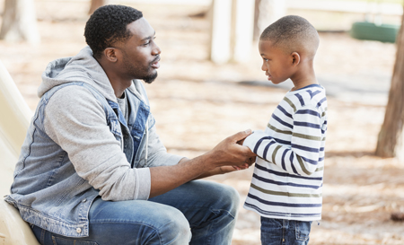 social norms_Black male adult with child