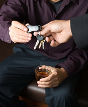 Photo of man with drink handing someone else his keys
