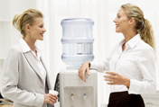 Women talking at the office water cooler