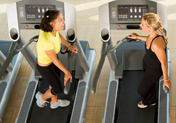 women talking on treadmills