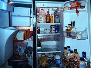 Photo of an open refrigerator with food inside