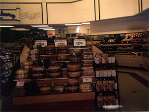 Photo of cakes and pastries being sold in a grocery store
