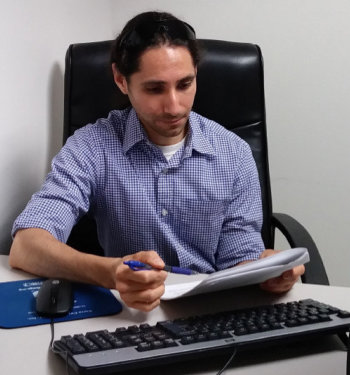 Victor Cabada reviewing data in an office