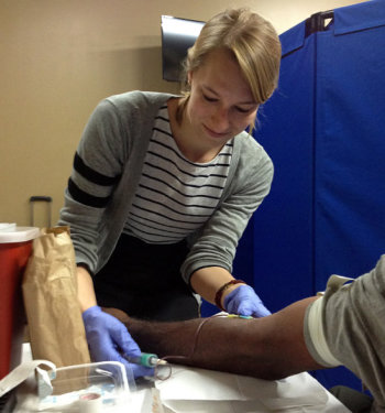 Lauren Linde preparing a patient for a blood test