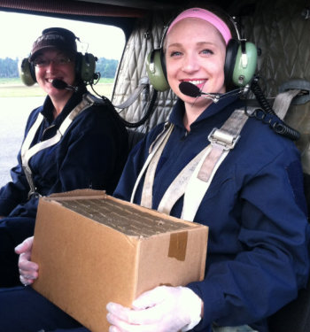 Katherine Mullican is a helicopter passenger with a carton of rabies vaccines