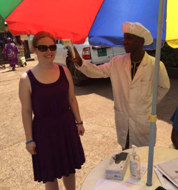 Emma Prasher at a temperature checkpoint in Guinea