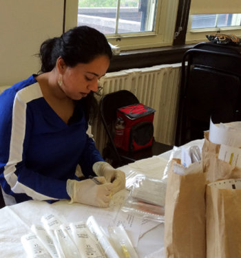 Mallika Sabharwal preparing patient samples