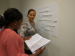 PHIFP fellows (l-r): Loretta Amadi and Ester Mungure strategize during a PHIFP learning session in August 2017