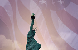 Statue of Liberty with an American flag background