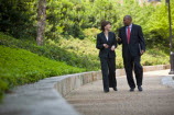 photo of two business people talking while walking outside