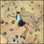 child climbing rock wall