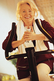 photo of woman on an exercise bike