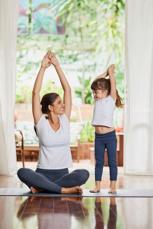 mother and daughter stretching
