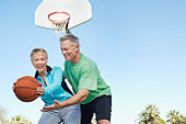 Older adults playing basketball