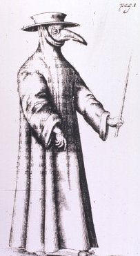 A person wearing a hat, a mask suggestive of a bird beak, goggles or glasses, and a long gown.