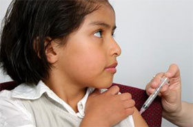 Photo of young girl receiving a polio vaccine injection