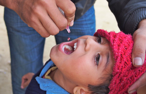 Child receiving the polio vaccine in Nepal