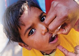 Photo of young boy receiving the oral polio vaccine
