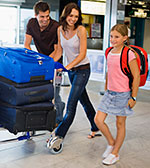 Family carting luggage