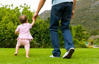 father and daughter walking in field