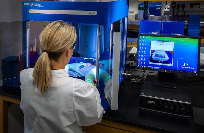 CDC scientist working with samples to be tested using a real-time PCR machine called a thermocycler to identify the various types of poliovirus.