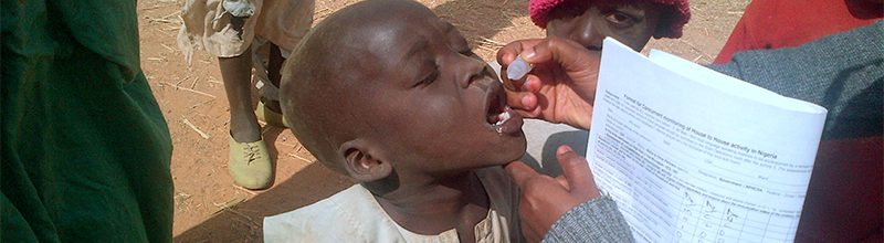 african american boy taking oral vaccine