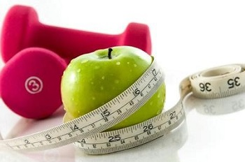 apples, weights, and measuring tape