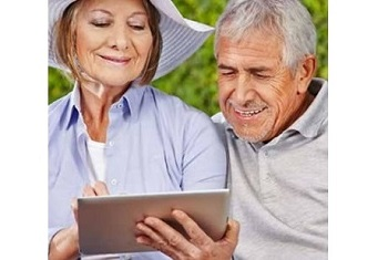Older couple looking over a touchscreen