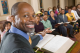 A Pastor smiling from the pulpit during a church service