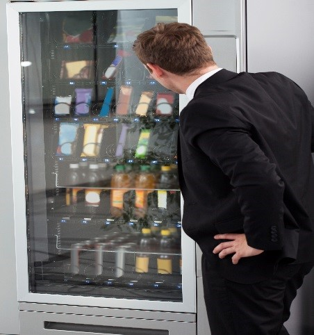 Employee searching for healthy vending machine choices