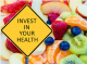 A road sign printed with the words: Invest in Your Health with a background of apples, peaches, oranges, and kiwi.